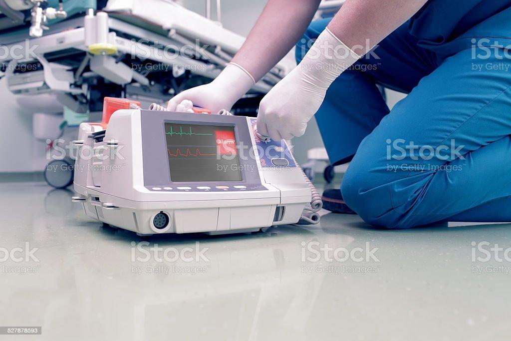 Doctor rescues patient in cardiac arrest stock photo