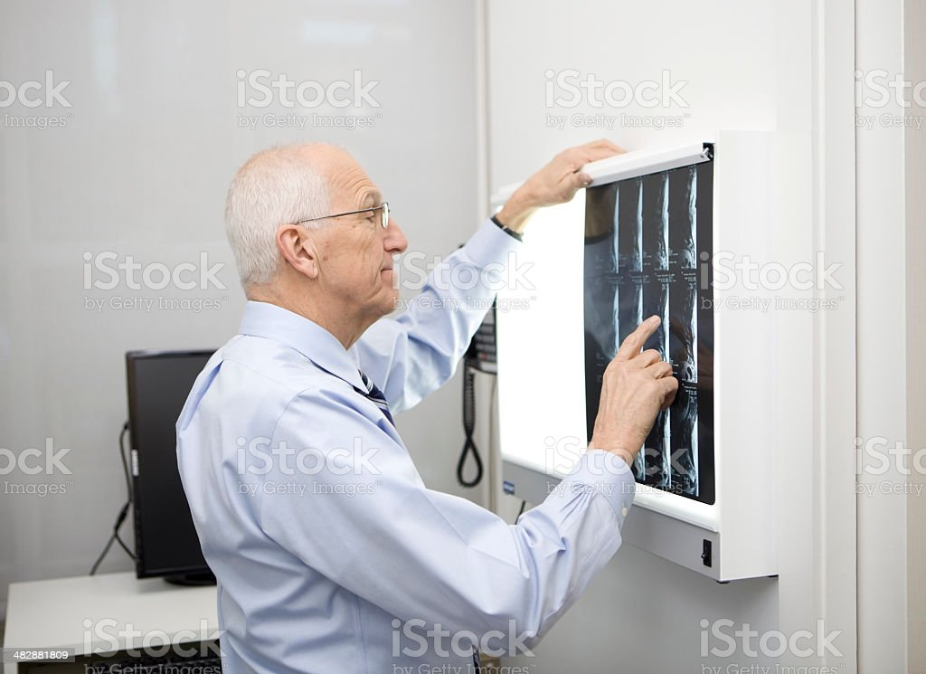 Doctor Reviewing MRI Scan royalty-free stock photo