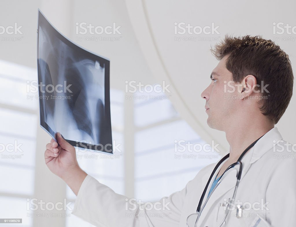 Doctor reviewing x-ray royalty-free stock photo