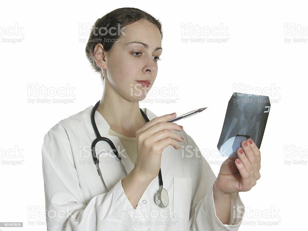 doctor reviews patient x-ray royalty-free stock photo