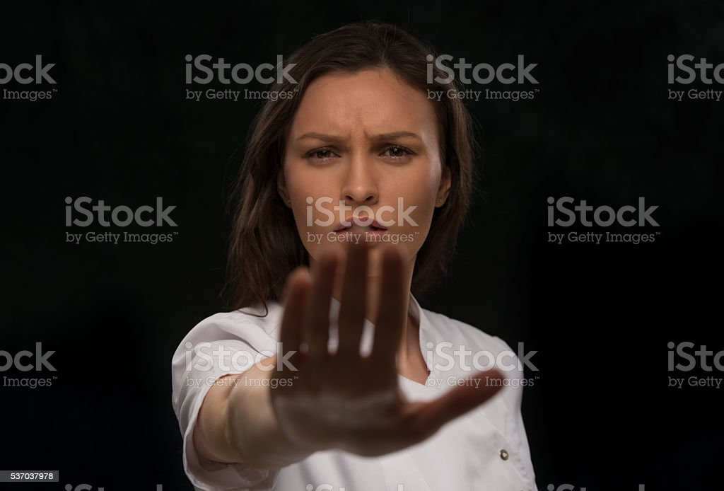 Doctor saying and showing stop gesture stock photo