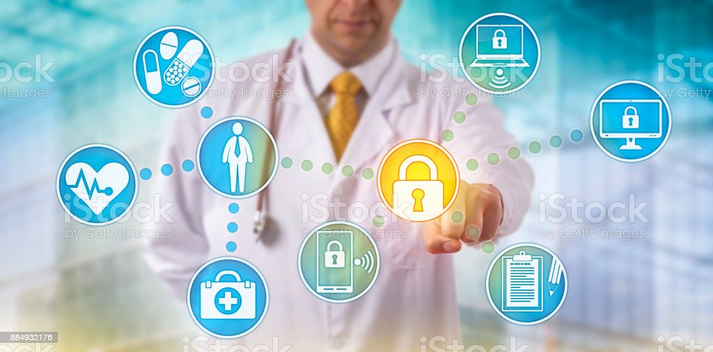 Doctor Securing Data Across Networked Devices stock photo