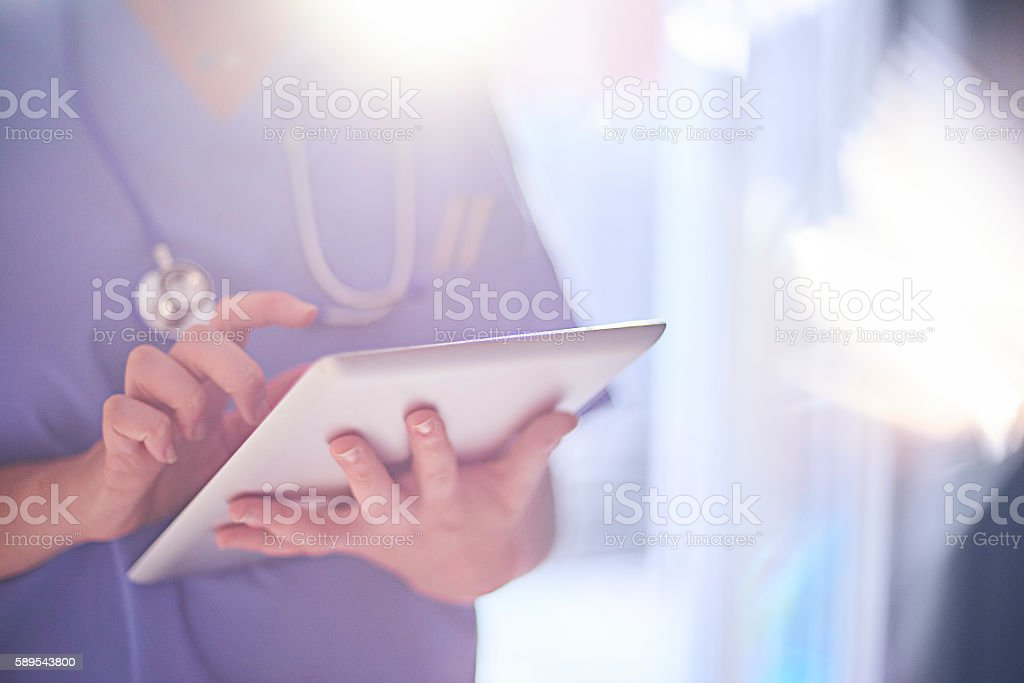 Doctor sending emails stock photo