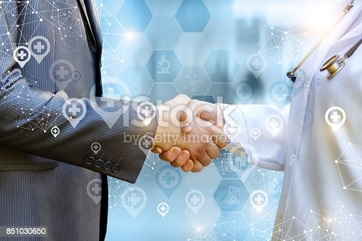 istock Doctor shakes hands with patient . 851030650