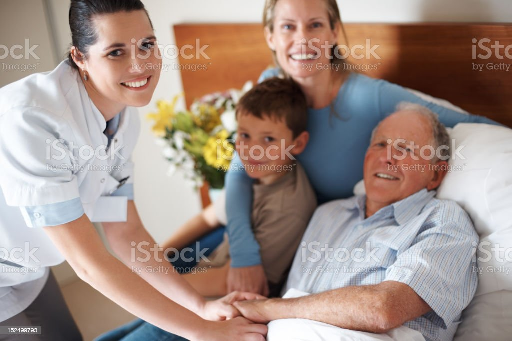 Doctor shaking hands with a recovered elderly man royalty-free stock photo