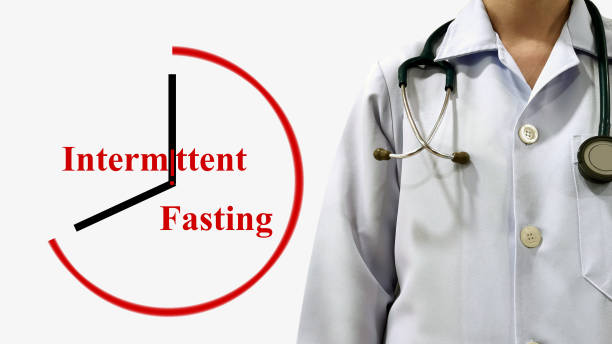 Doctor show Intermittent fasting. Intermittent energy restriction is meal timing schedules cycle between voluntary(reduced calories intake)and non-fasting over given period. Medical health concept stock photo
