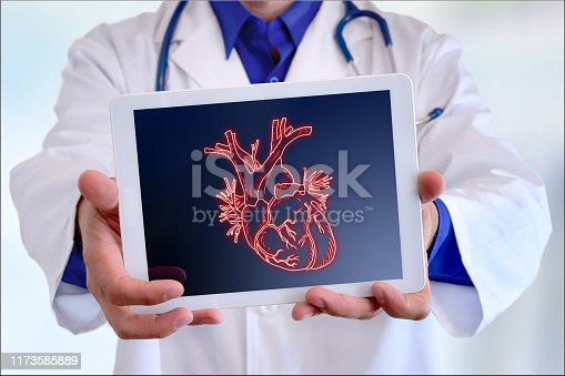 Doctor showing a picture of a heart on a tablet in a hospital