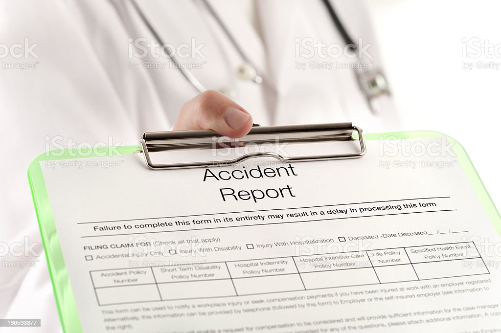 Doctor Showing An Accident Report Stock Photo & More