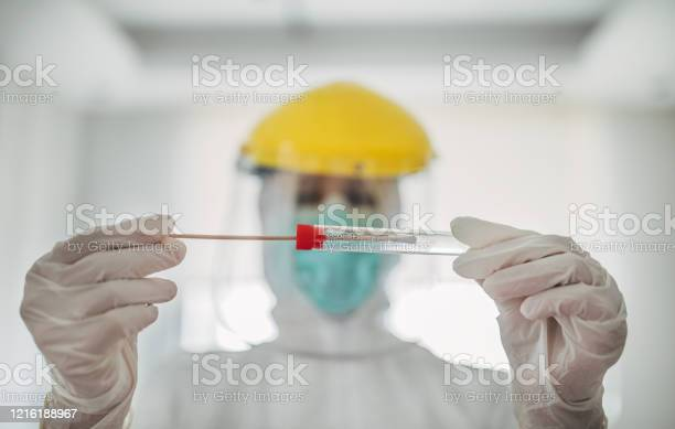 Doctor Showing Covid19 Tube Test And Sampling Swab Stock Photo - Download Image Now