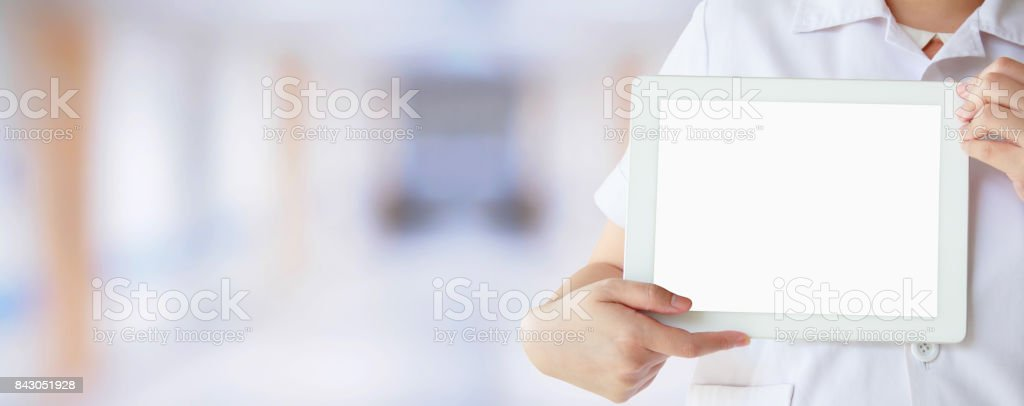 Doctor showing digital tablet with blank screen at the hospital....