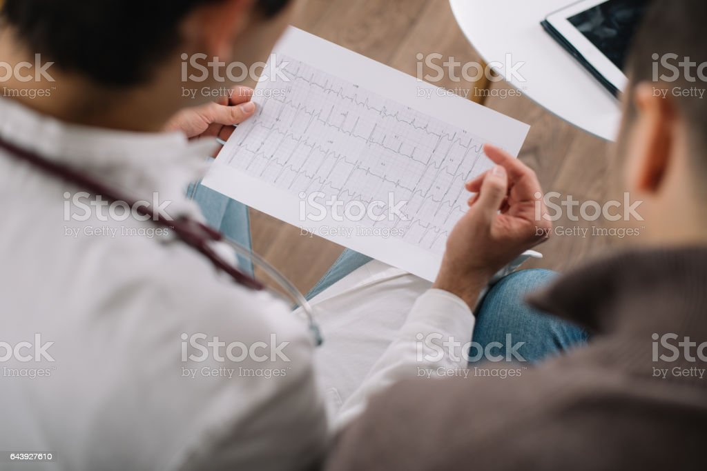 Doctor showing ECG results to a patient stock photo