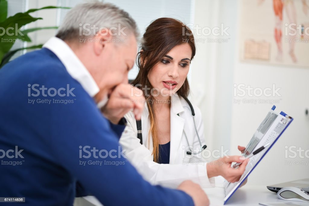 Doctor showing medical tests results to a patient royalty-free stock photo