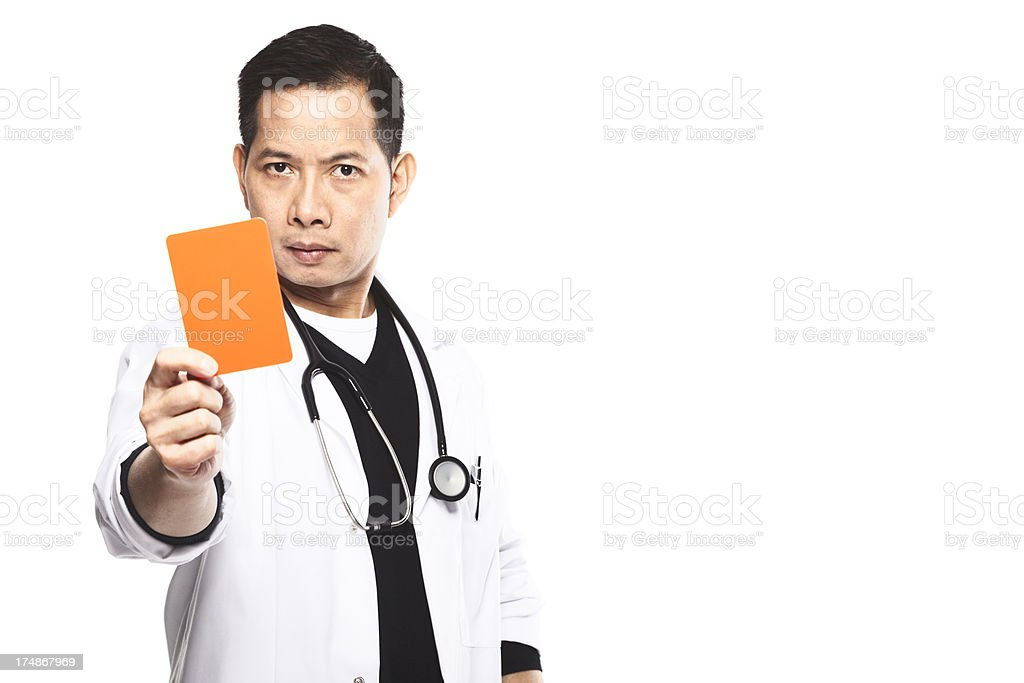 Doctor showing red card to a patient. stock photo