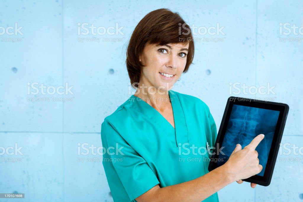 Doctor showing X-ray on tablet royalty-free stock photo