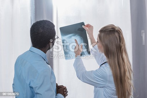 istock Doctor showing x-ray to patient 961963670