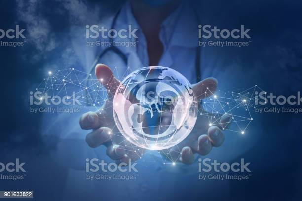Doctor shows a human embryo on the background of the planet earth picture id901633822?b=1&k=6&m=901633822&s=612x612&h=h gygs1zrx3vyn5gakiydiwzmbeju9hd6s5adtxltyw=