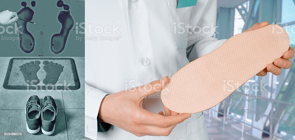 Doctor shows Individual orthopedic insoles stock photo