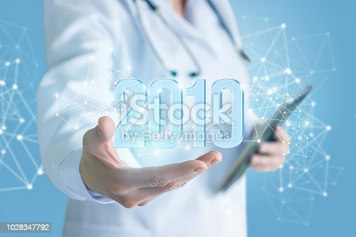 istock Doctor shows numbers 2019 . 1028347792