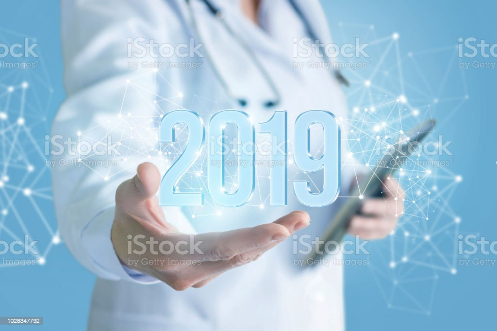 Doctor shows numbers 2019 . stock photo