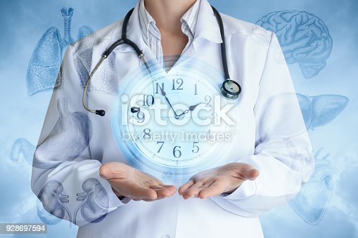istock Doctor shows the clock on the background of internal organs . 928697594