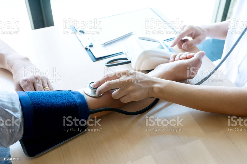 doctor sit test Pressure gauge and exam to the patient , doctor give...
