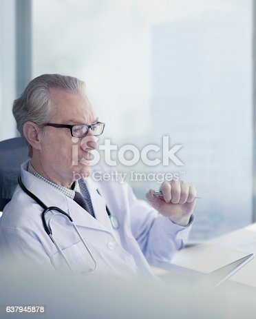 istock Doctor sitting and thinking alone in medical office 637945878