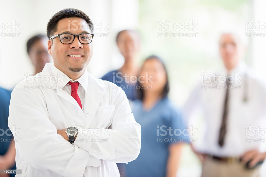 Doctor Standing with a Group of Nurses royalty-free stock photo