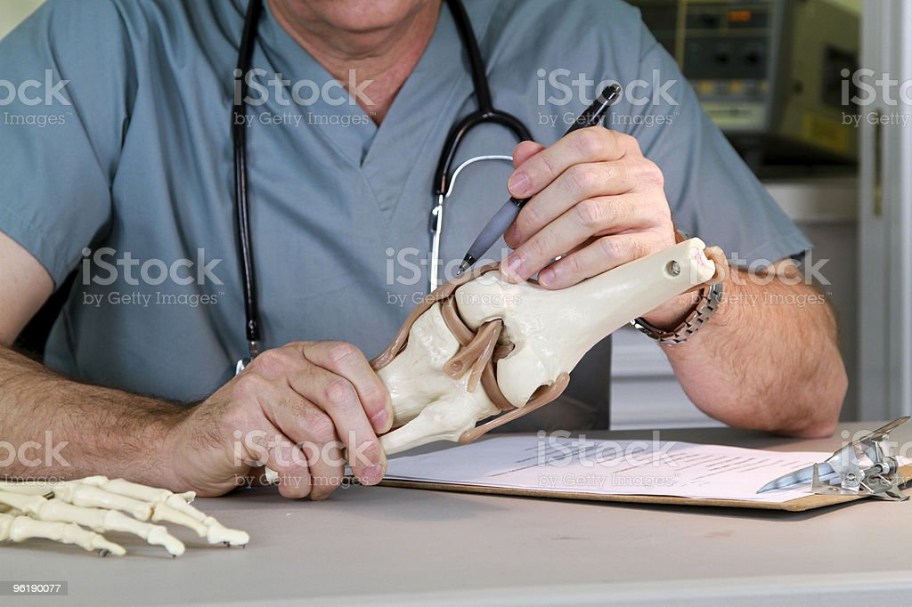 doctor studying a knee joint stock photo