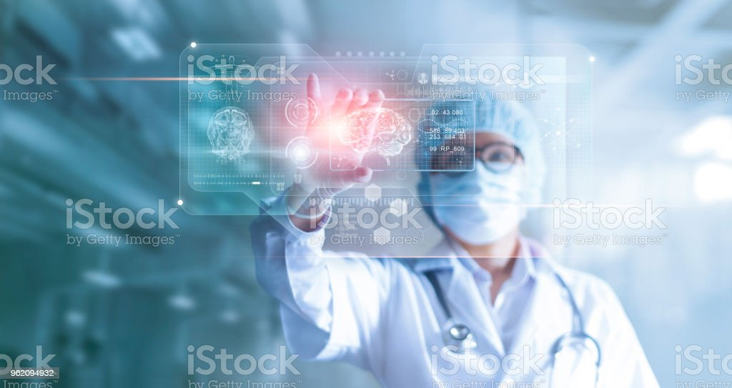 Doctor, surgeon analyzing patient brain testing result and human anatomy on technological digital futuristic virtual computer interface, digital holographic, innovative in science and medicine concept stock photo
