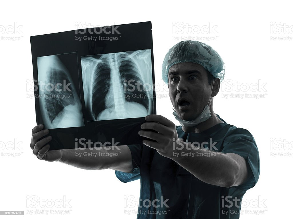 doctor surgeon radiologist surprised examining lung torso x-ray royalty-free stock photo