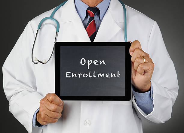 doctor tablet computer open enrollment - open enrollment stock photos and pictures