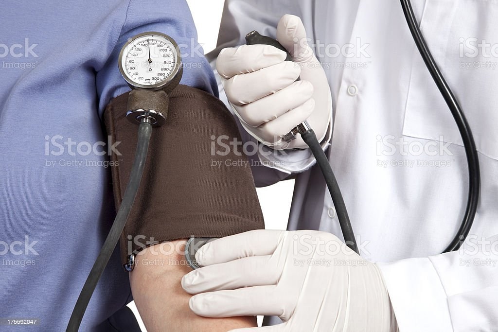 Doctor taking Blood Pressure on patient, gauge visible royalty-free stock photo