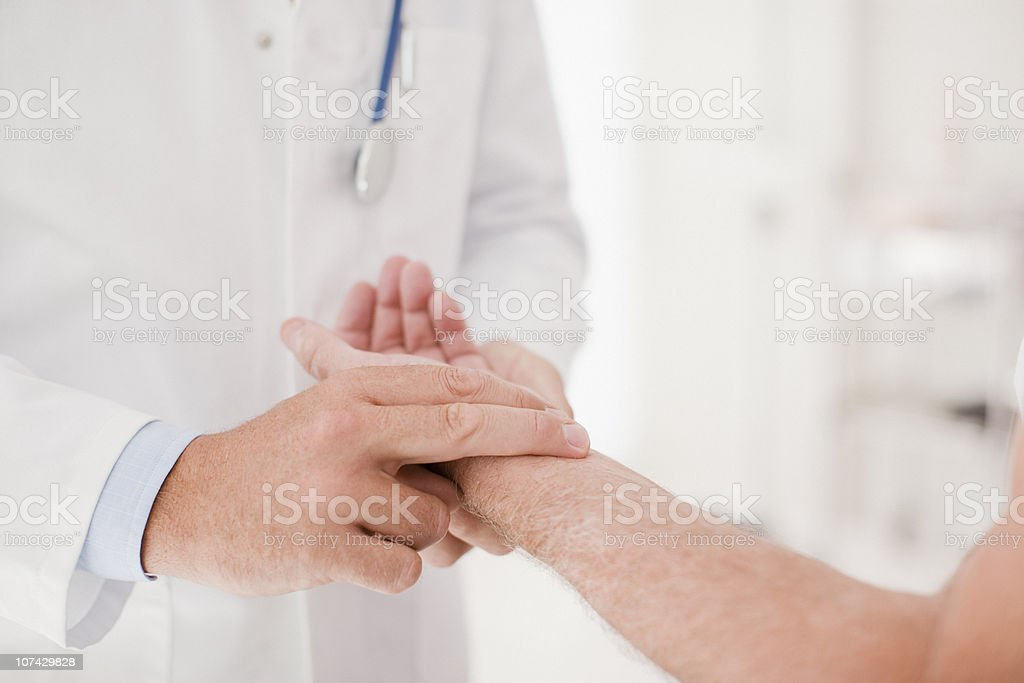Doctor taking patients pulse stock photo