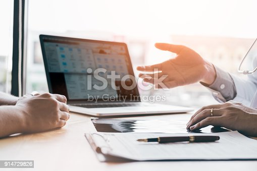 873418972istockphoto Doctor talking and discussion about x-ray film sheet with patient at desk room office in hospital. 914729826