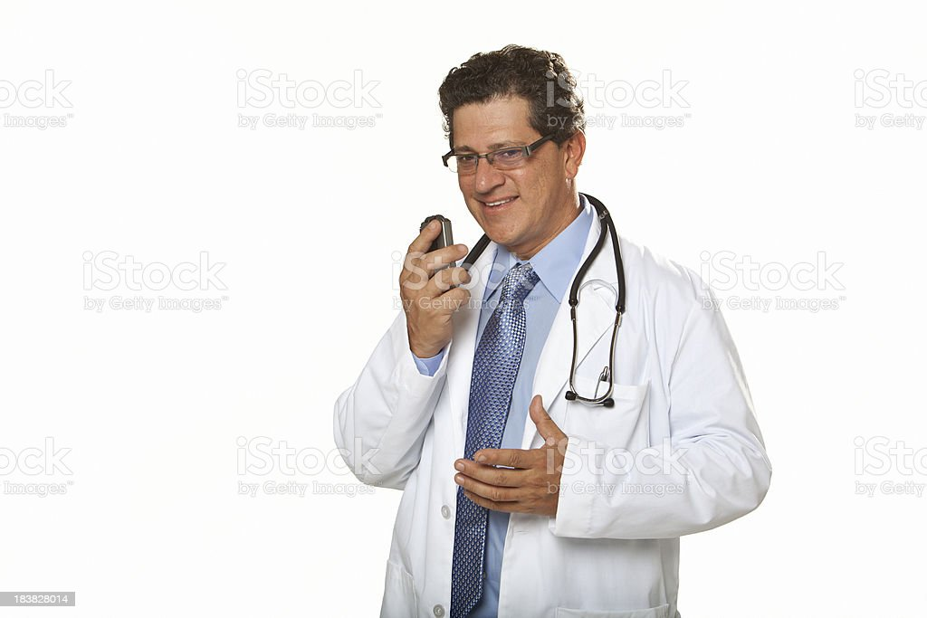 Doctor talking into Dictaphone stock photo