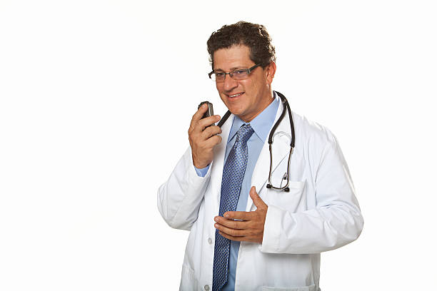 doctor talking into dictaphone - dictaphone stock pictures, royalty-free photos & images