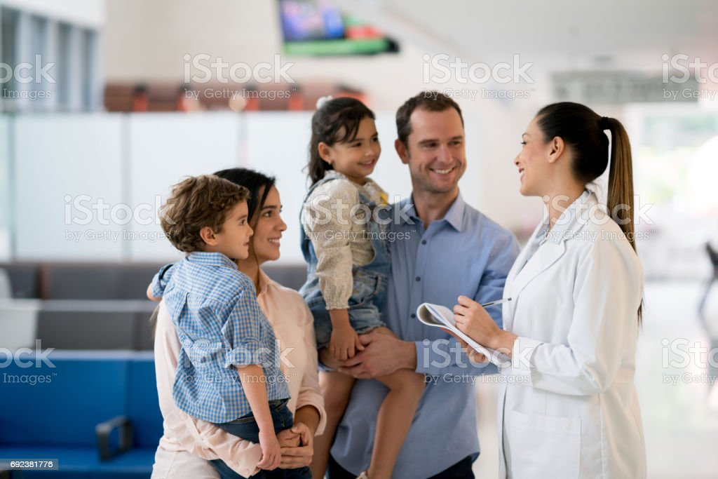 Doctor talking to a family at the hospital stock photo