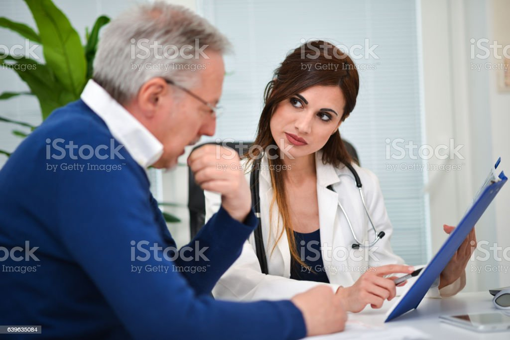 Doctor talking to her patient stock photo
