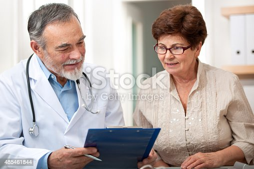 istock Doctor talking to his female senior patient 485461844