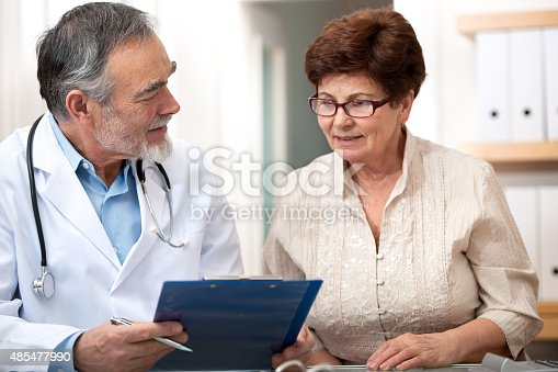 istock Doctor talking to his female senior patient 485477990