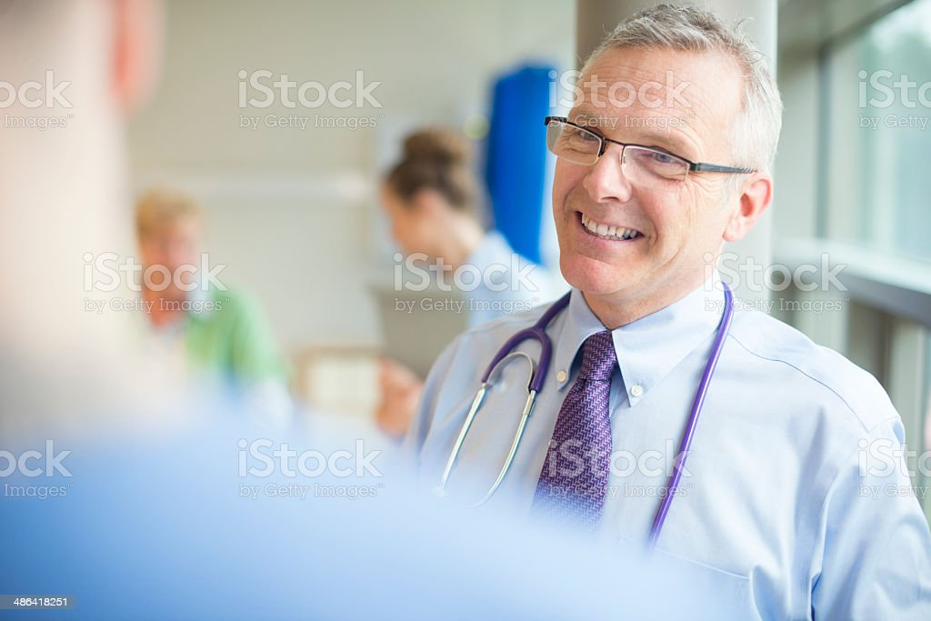 doctor talking to medical staff stock photo