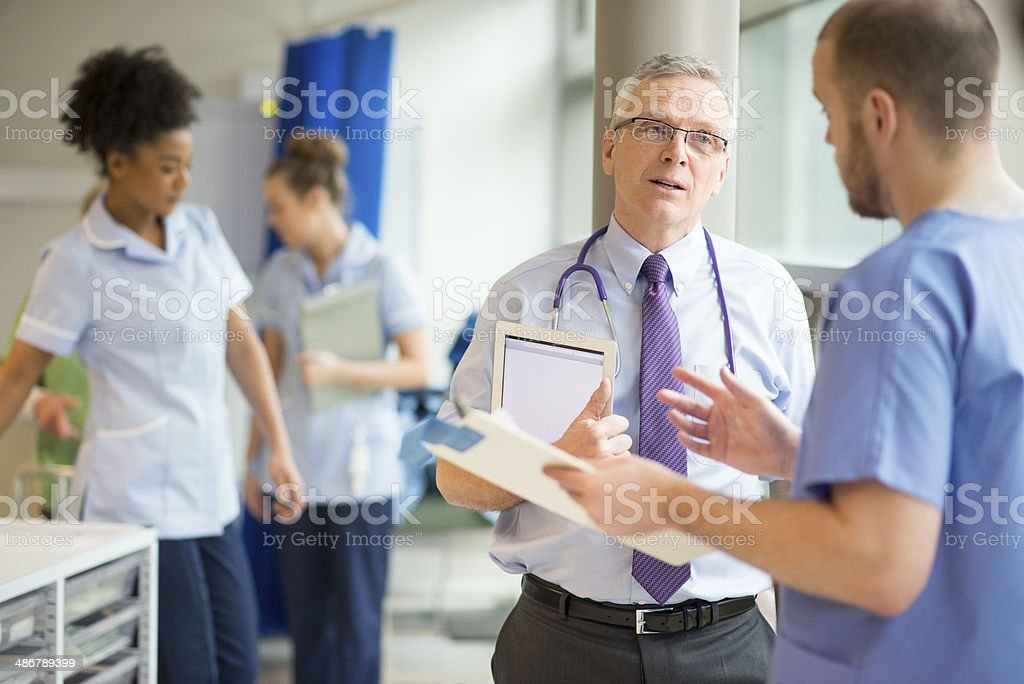 doctor talking to medical staff royalty-free stock photo