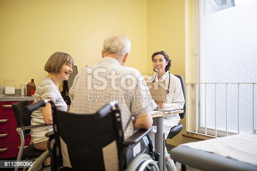 istock Doctor talking to senior couple at clinic 811286090