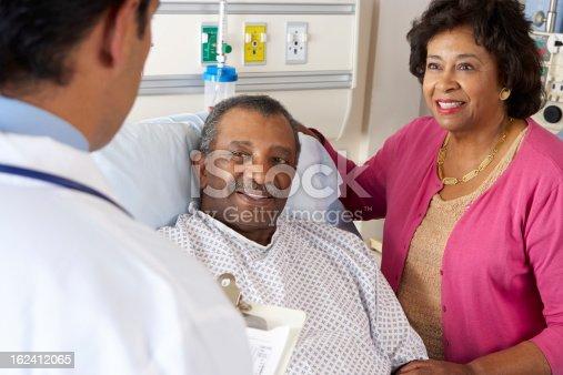 istock Doctor Talking To Senior Couple On Ward 162412065
