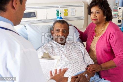 istock Doctor Talking To Senior Couple On Ward 177730491