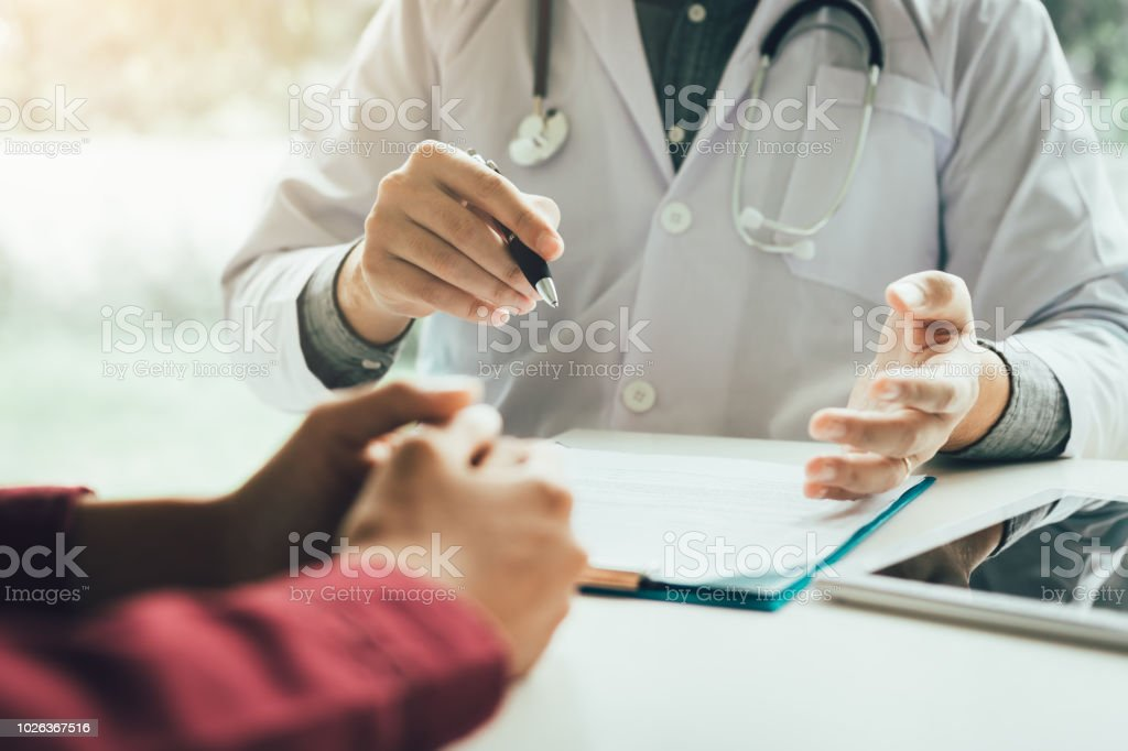 Doctor talking to the patient about menopause and treatment in future. stock photo