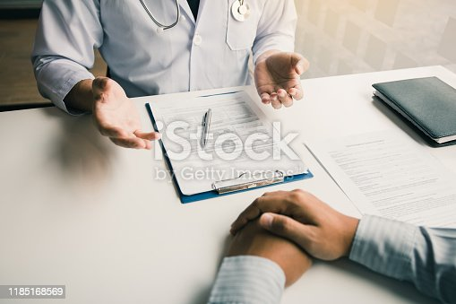 1026367516 istock photo Doctor talking to the patient about menopause and treatment in future. 1185168569