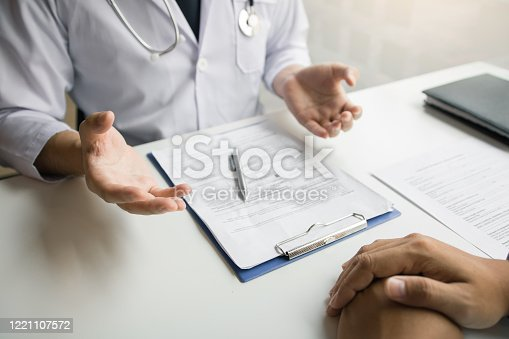 1026367516 istock photo Doctor talking to the patient about menopause and treatment in future. 1221107572