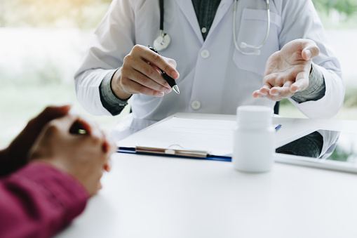 873418972 istock photo Doctor talking to the patient about suggest the properties of medicines in clinic office. 1137970916