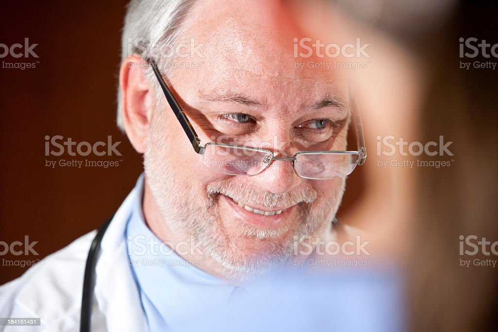Doctor talking with patient or nurse stock photo